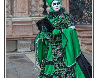 green and black costume: female and male