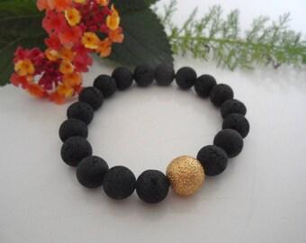 Bracelet lava with Goldkugel Diamond cut