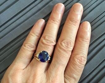 Blue Sapphire Ring. Blue Sapphire with Half Moon diamond ring.