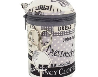 With small round grey sewing kit