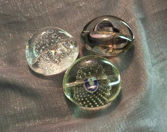 3 signed glass  paper weights