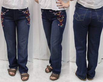 90s does 70s style straight leg blue jeans with embroidered design at hips size 4 small