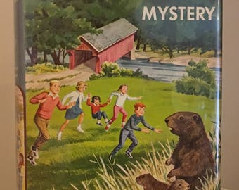 The Happy Hollisters and the Whistle Pig Mystery by Jerry West in Dust Jacket