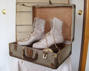 1940s roller skates with suitcase and wrench. Size 7 Hyde white leather with wood wheels.