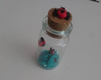 Miniature jar clay ladybug