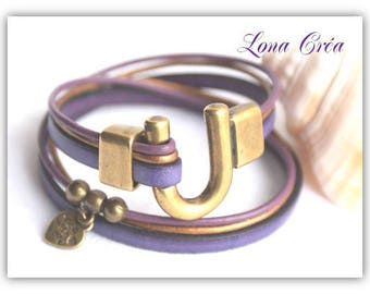 Bracelet leather cord purple cords purple and bronze clasp Bronze beads and charms bronze