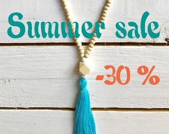 SUMMER SALE / / / boho Wood necklace & evil eye / / / turquoise blue tassel