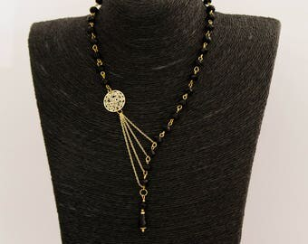 Necklace with beads of black glass and chains and gold plated pendant