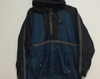 Vintage Adidas Windbreaker Hoodie jacket size. M-L