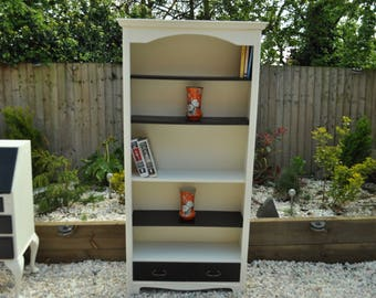 Display cabinet/book shelving beautiful hand painted piece, ivory and black with cornice and drawers at the bottom