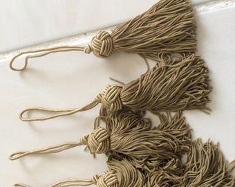 Khaki color length 9 cm tassels