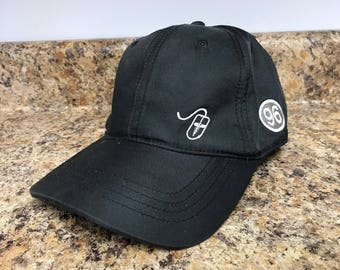 Practice Link Black and white Dad hat/baseball cap Computer graphics throughout Adjustable strap in back One size fits all
