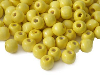200 wooden beads 10 x 9 mm, yellow
