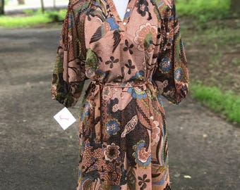 1970s brown chiffon dress with green orange and  blue designs