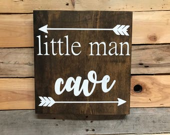 Little Man Cave with arrows sign