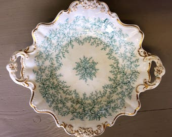 A 19th Century Two-handled Plate Decorated with Green Fronds