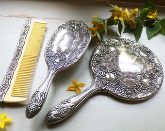Dressing table set, c1960s; hairbrush, mirror and comb; dressing accessories; bedroom accessories; vanity set