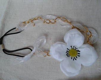 gold chain and white flower headband