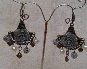 bronze earrings and gray flower