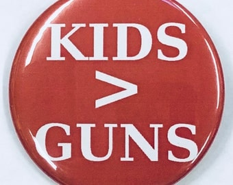 "2 1/4"" pinback button. Kids > Guns"