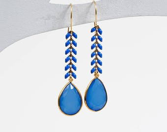 Earrings in silver gilded with fine gold, enamel and resin