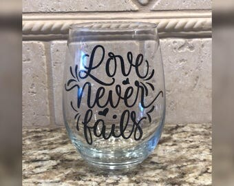 Love Never Fails Wine Glass