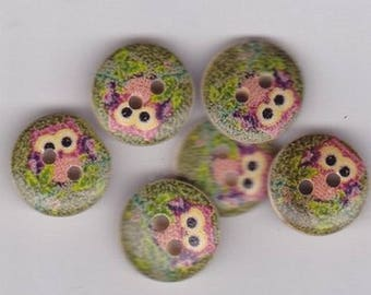 Eight round buttons with a print of owls