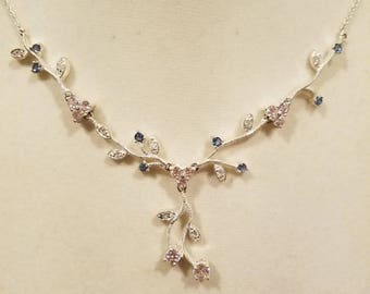 Beautiful necklace silver with pink and blue stones.