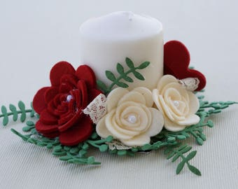Candle decorated with roses