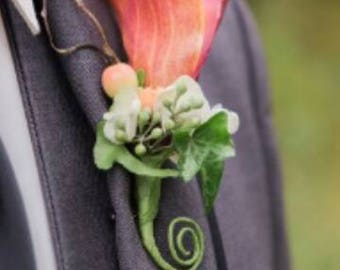 Burnt orange calla lily boutonnier for groom or groomsmen