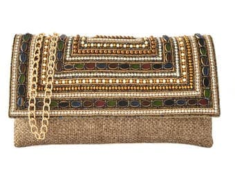 Beige beaded shoulder bag with detachable chain strap, doubles as a clutch bag