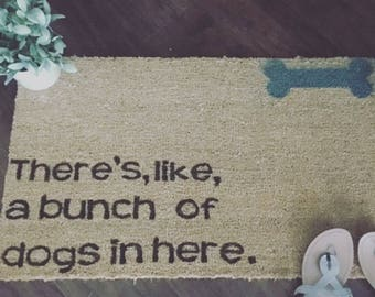 Theres, like, a bunch of dogs here door mat