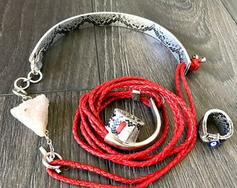 red leather with snake collar with white drizzled stone with silver straps