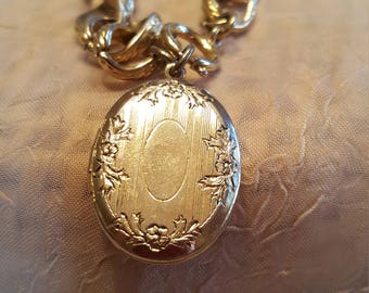 Locket bracelet..gold tone with a chunky chain.