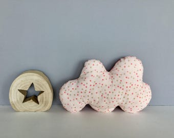 Pink cloud shaped pillow with star