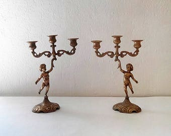 Pair of angels/cherubs brass candlesticks. French countryside.