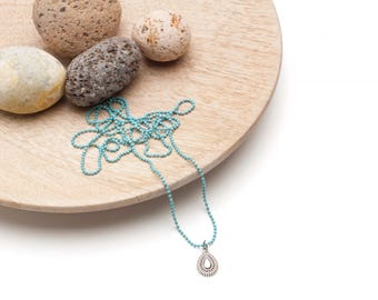 Ethnic pendant with turquoise chain necklace