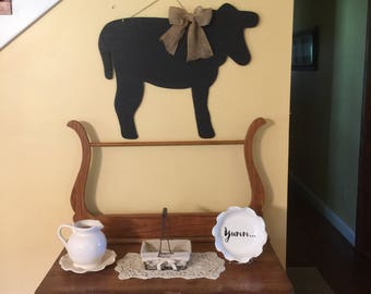 Wooden Cow painted with black board paint