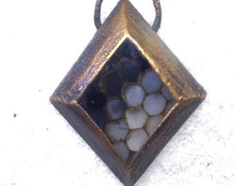 Copper formed black and white hornets nest pendant