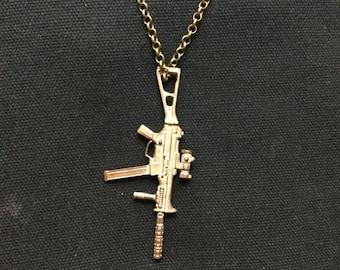 Sub machine gun uzi pendant in bronze.