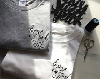 Embroidered unisex 'living my best life' Tshirt in Grey