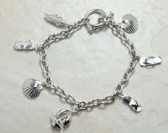 Complete Beach Theme Silver Charm Bracelet.Silver with 7 Charms attached.Ready made Bracelet with individual 7 Charms.Perfect Christmas Gift