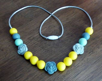 Yellow, mint, and gray teething/nursing necklace with roses.