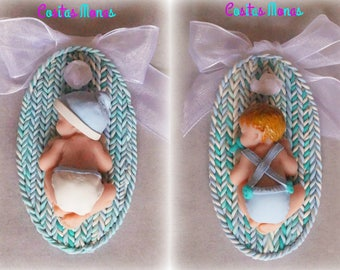 Pack of two door on the occasion of baby hangers made of polymer clay for interior decoration.