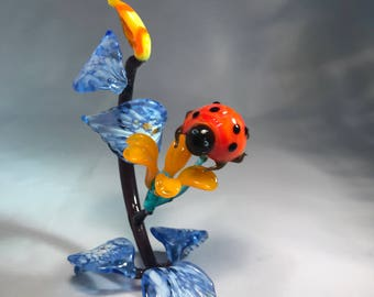 Ladybug on the flower composition