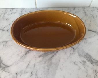 Light brown casserole dish