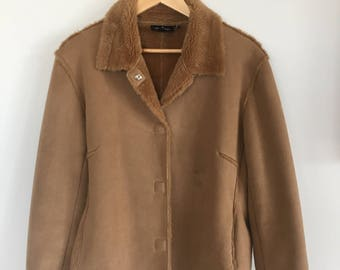 brown winter jacket with faux fur lining. size 12