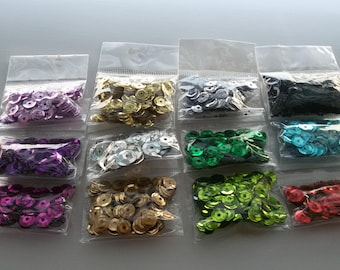 set of 12 packets of sequins