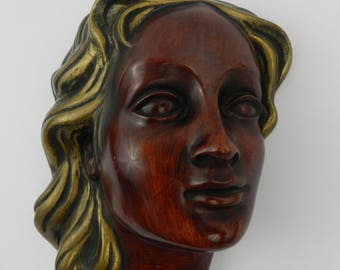 Wall mask of a young woman - Achatit, Germany