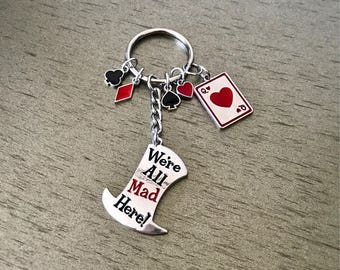 "Alice in wonderland ""we're all mad here"" keychain"